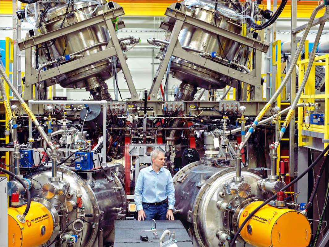 Dr. Michl Binderbauer, Tri-Alpha Energy's CTO, near the core of his firm's fusion reactor in Foothill Ranch, Calif.